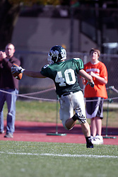 04 October 2008: John Meacham holds the ball out as he crosses the goal line for a touchdown in a battle between the Carthage Red Men and the Illinois Wesleyan University Titans, Game action was at Wilder Field on the campus of Illinois Wesleyan University in Bloomington Illinois.