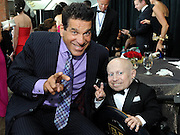 "Actors Lou Ferrigno and Verne Troyer pose for a picture at the Starkey Hearing Foundation's ""So the World May Hear"" Awards Gala on Sunday, July 20, 2014 in St. Paul, Minn. The foundation gives away more than 100,000 hearing aids in the U.S. and around the world annually. (Photo by Diane Bondareff/Invision for Starkey Hearing Foundation/AP Images)"
