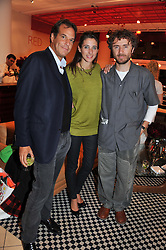 Left to right, BRENT HOBERMAN, CHLOE MACINTOSH and THOMAS HEATHERWICK at an exhibition at The Conran Shop entitled Red to celebrate 25 years of The Conran Shop at the Michelin Building, 81 Fulham Road, London on 19th September 2012.