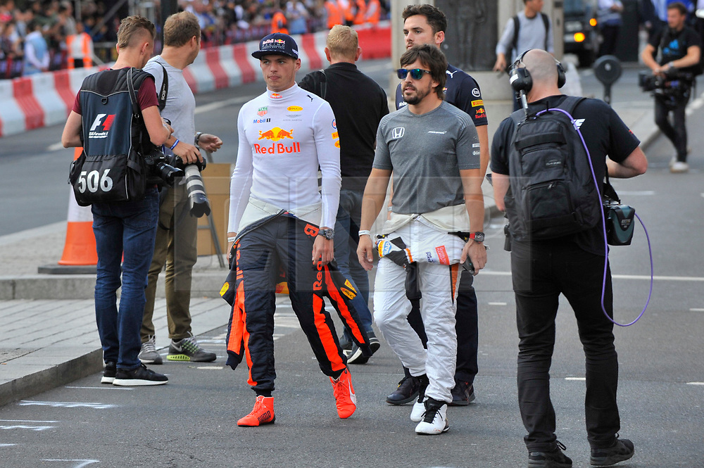 © Licensed to London News Pictures. 12/07/2017. London, UK.   (L to R) Max Verstappen and Fernando Alonso meet the public ahead of taking part in a parade of Formula One cars around a circuit passing Trafalgar Square and Whitehall during a promotional event called F1LiveLondon ahead of the British Grand Prix at Silverstone.   Photo credit : Stephen Chung/LNP