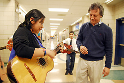 "USA, Chicago, June 4th, 2009.  Young ""mariachi"" Ivette Espinoza is able to maintain a strong link to her Mexican cultural heritage through classes offered at several Pilsen schools.  Veteran musician Victor Pichardo, of the band ""Sonos de Mexico,"" and his son Yahvi, a former CPS music teacher, began a pilot program in 2008 which enables students to build upon their skills year after year."