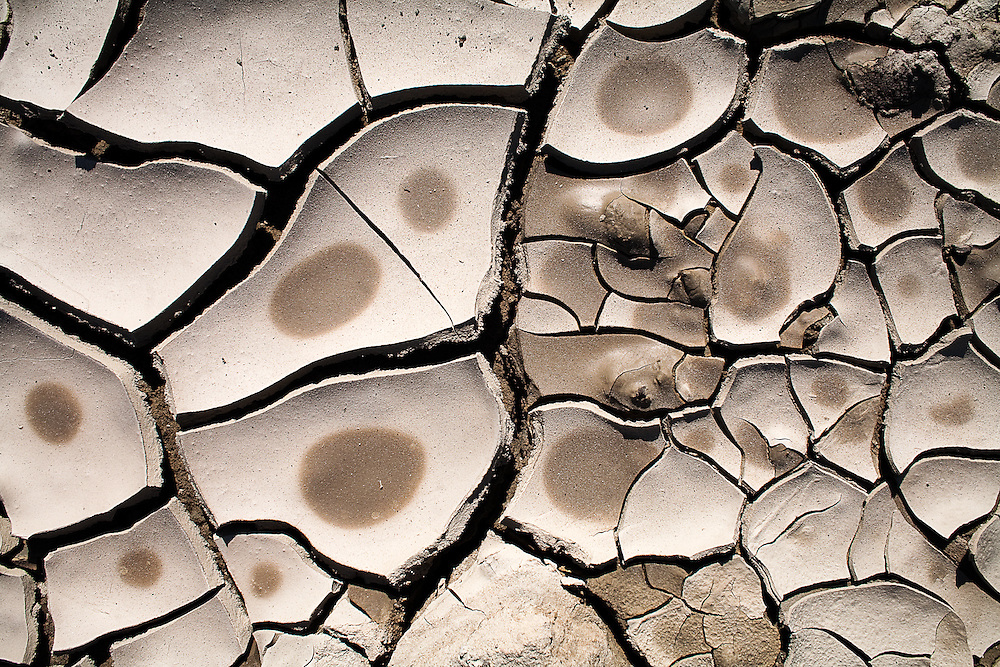 Cracked clay earth dries in the San Joaquin valley.