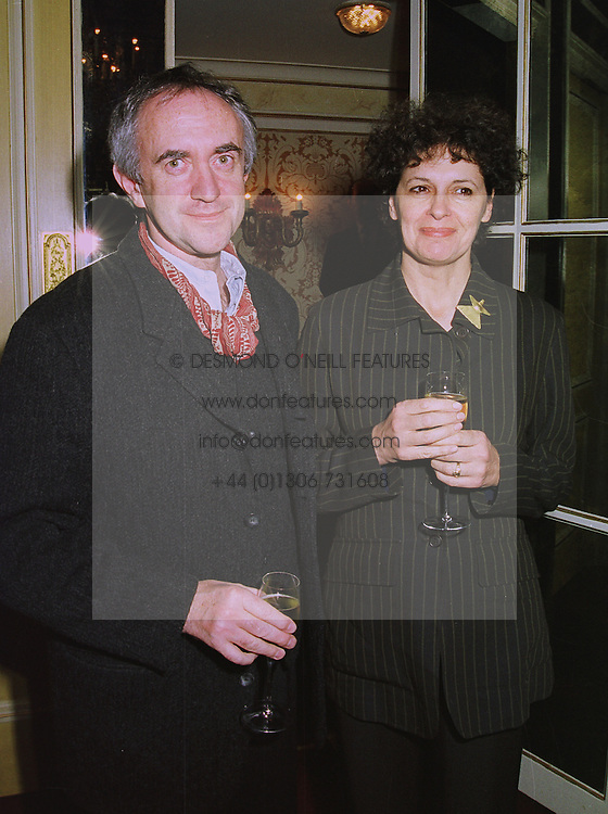 MR & MRS JONATHAN PRICE, he is the actor, at a party in London on 1st December 1997.MDW 33