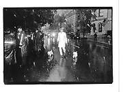 Man walking dogs in rain 5th Ave N.Y© Copyright Photograph by Dafydd Jones 66 Stockwell Park Rd. London SW9 0DA Tel 020 7733 0108 www.dafjones.com