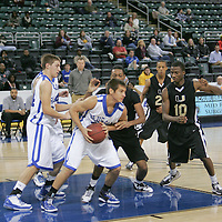 Washing forward Luke Schroepher (30) looks for open men while being double teamed by UCity defenders