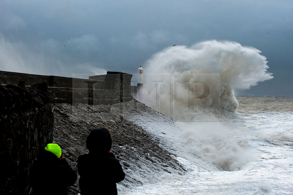 © Licensed to London News Pictures. 02/11/2019. Porthcawl, UK. Huge waves crash against the harbour wall as gale force winds and rain lash the seaside resort of Porthcawl in Bridgend, UK. Photo credit: Graham M. Lawrence/LNP