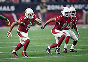 Arizona Cardinals wide receiver Michael Floyd (15), Arizona Cardinals wide receiver Larry Fitzgerald (11), and Arizona Cardinals wide receiver John Brown (12) go out for a pass during the NFL NFC Divisional round playoff football game against the Green Bay Packers on Saturday, Jan. 16, 2016 in Glendale, Ariz. The Cardinals won the game in overtime 26-20. (©Paul Anthony Spinelli)