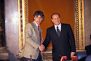 Umberto Bossi, President of Lega Nord (political party) shake hand with Silvio Berlusconi, President af Forza Italia, at a common press conference with Pier Ferdinando Casini, Secretary of new party Centro Cristiano Democratico, Milan, February 5, 1994. © Carlo Cerchioli