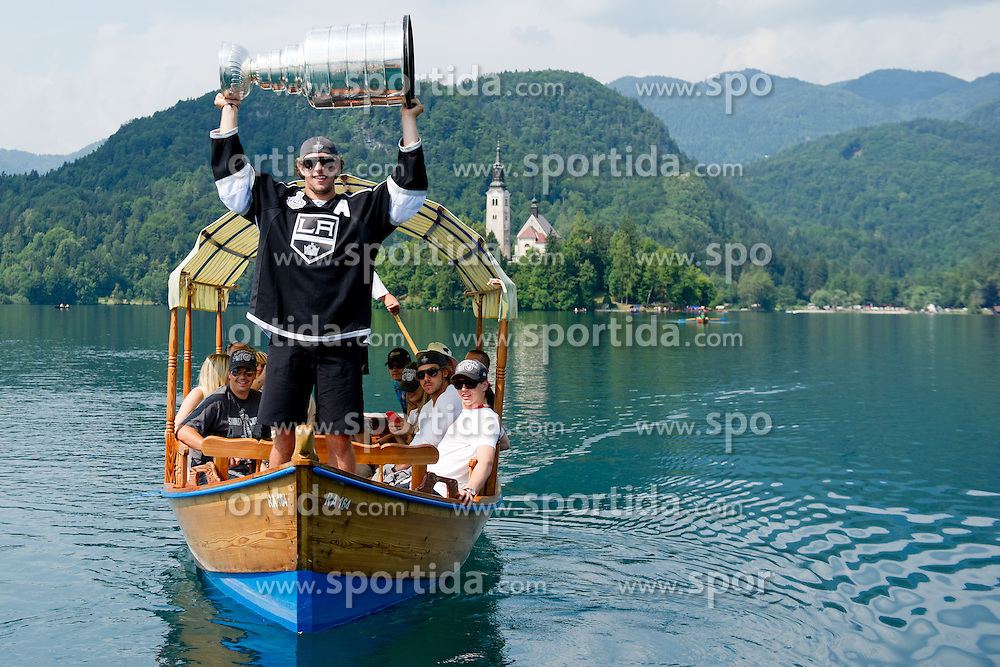Anze Kopitar with trophy on boat at Ice Hockey NHL Champion Anze Kopitar of LA Kings with Stanley Cup in Slovenia, on July 6, 2012 in Bled, Slovenia. (Photo by Matic Klansek Velej / Sportida)