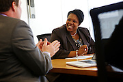 D.C. Public Schools Chancellor Kaya Henderson meets Nathaniel Beers, left,.chief of the Office of Special Education and Tom Flanagan, Interim deputy chief for programming, on Friday, Nov. 16, 2012 in Washington, D.C. Henderson recently announced that she plans to close 20 under-enrolled schools across the district. CREDIT: Lexey Swall for The Wall Street Journal