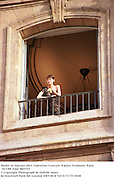 Model on balcony after Valentino. Couture. 8 place Vendome, Paris. 19/7/98. Film 98557f3<br />