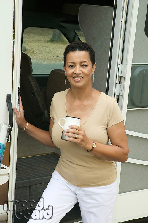 Woman with Coffee near RV