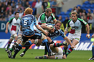 Cardiff Blues no 8 Xavier Rush is tackled. Cardiff Blues v Harlequins , Heineken cup match at the Cardiff City Stadium on Sat 10th Oct 2009. pic by Andrew Orchard
