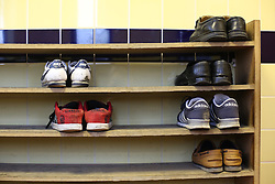 © Licensed to London News Pictures. 07/02/2015. Leeds, UK. Shoes left on shelves at the entrance of Leeds Grand Mosque in West Yorkshire as mosques all over Britain open their doors to non-muslims to explain their faith beyond the hostile headlines. This is the second 'Visit My Mosque Day' with the first being last year. Organised by the Muslim Council of Britain, last year's event attracted hundreds of visitors for tours, talks and tea. Photo credit : Ian Hinchliffe/LNP