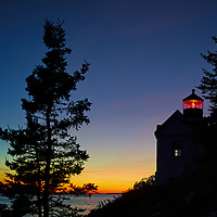 Silhouette of the Bass Harbour Head working lighthouse at sunset in Acadia National Park Maine.