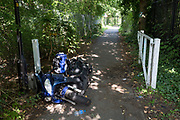 A crashed motorbike scooter left abandoned on a path in south London, on 2nd September 2017, in London, England.