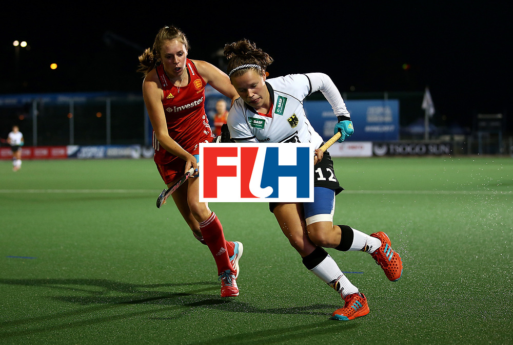 JOHANNESBURG, SOUTH AFRICA - JULY 14: Charlotte Stapenhorst of Germany controls the ball from Giselle Ansley of England during day 4 of the FIH Hockey World League Women's Semi Finals Pool A match between Germany and England at Wits University on July 14, 2017 in Johannesburg, South Africa.  (Photo by Jan Kruger/Getty Images for FIH)