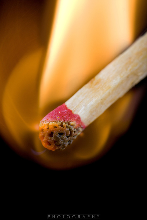 a single red match ignites on fire and burns brightly...Photo by Jason Doiy