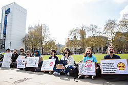 London, UK. 14th April 2019. Young anti-fracking campaigners from UK Youth Climate Coalition (UKYCC) with taped mouths hold a silent protest in Parliament Square to repeat their request for a meeting with Minister for Energy and Clean Growth Claire Perry, to highlight how young people's voices are marginalised and to call on the Government to ban fracking.