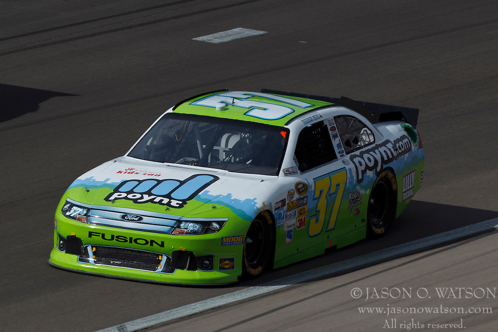 Mar 11, 2012; Las Vegas, NV, USA;  Sprint Cup Series driver Timmy Hill (37) during the Kobalt Tools 400 at Las Vegas Motor Speedway. Mandatory Credit: Jason O. Watson-US PRESSWIRE