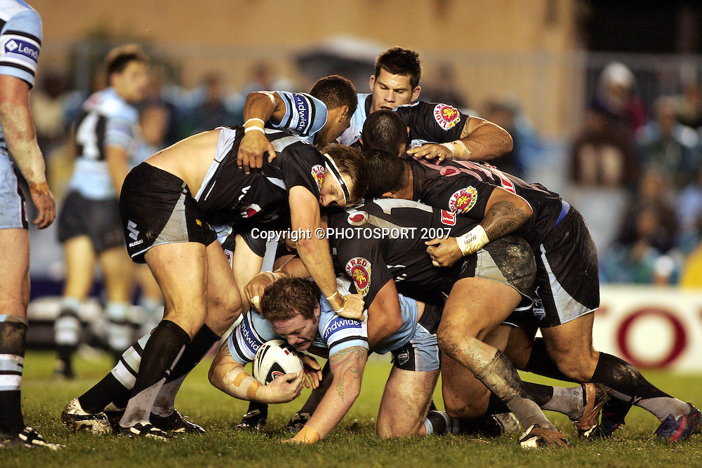 Craig Stapleton tackled by Michael Luck.<br /> Sharks v Warriors. NRL.<br /> Toyota Park, Cronulla, Australia.<br /> Saturday 16 June 2007. <br /> Photo: Paul Seiser/PHOTOSPORT<br /> #NO COMMERCIAL USE#