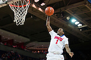 DALLAS, TX - NOVEMBER 26: Ryan Manuel #1 of the SMU Mustangs dunks the ball against the Texas Southern Tigers on November 26, 2014 at Moody Coliseum in Dallas, Texas.  (Photo by Cooper Neill/Getty Images) *** Local Caption *** Ryan Manuel