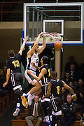San Francisco Dons center Jimbo Lull (5) dunks over the SFSU defense at Kezar Pavilion in San Francisco, Calif., on December 6, 2016. (Stan Olszewski/Special to S.F. Examiner)