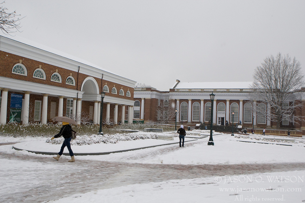 Students walk past the Special Collections Library at the University of Virginia during a snow storm in Charlottesville, Virginia on January 18, 2008.