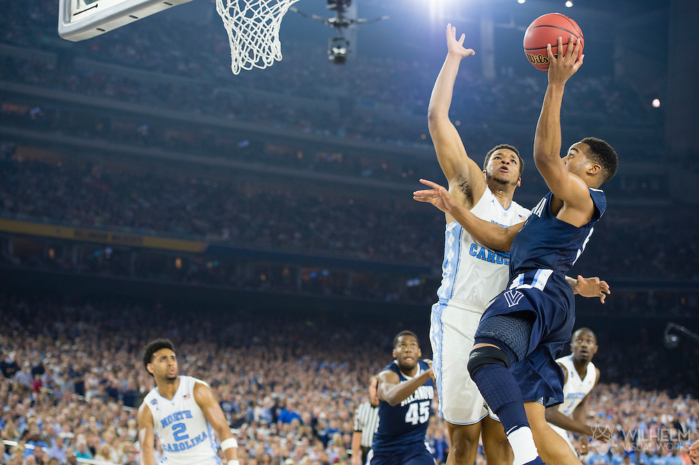 04 APR 2016: Guard Phil Booth (5) of Villanova University lays up a shot under Forward Kennedy Meeks (3) of the University of North Carolina during the 2016 NCAA Men's Division I Basketball Final Four Championship game held at NRG Stadium in Houston, TX. Villanova defeated North Carolina 77-74 to win the national title. Brett Wilhelm/NCAA Photos