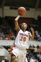 Denesha Kenion (20) attempts a layup against NC State.  The Wolfpack beat the Wahoos 73-63 at University Hall.