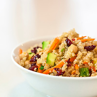 Rainbow Quinoa Salad in a white bowl on a white background.