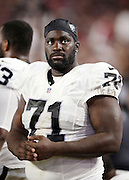 Oakland Raiders tackle Menelik Watson (71) looks on from the sideline during the 2016 NFL preseason football game against the Arizona Cardinals on Friday, Aug. 12, 2016 in Glendale, Ariz. The Raiders won the game 31-10. (©Paul Anthony Spinelli)