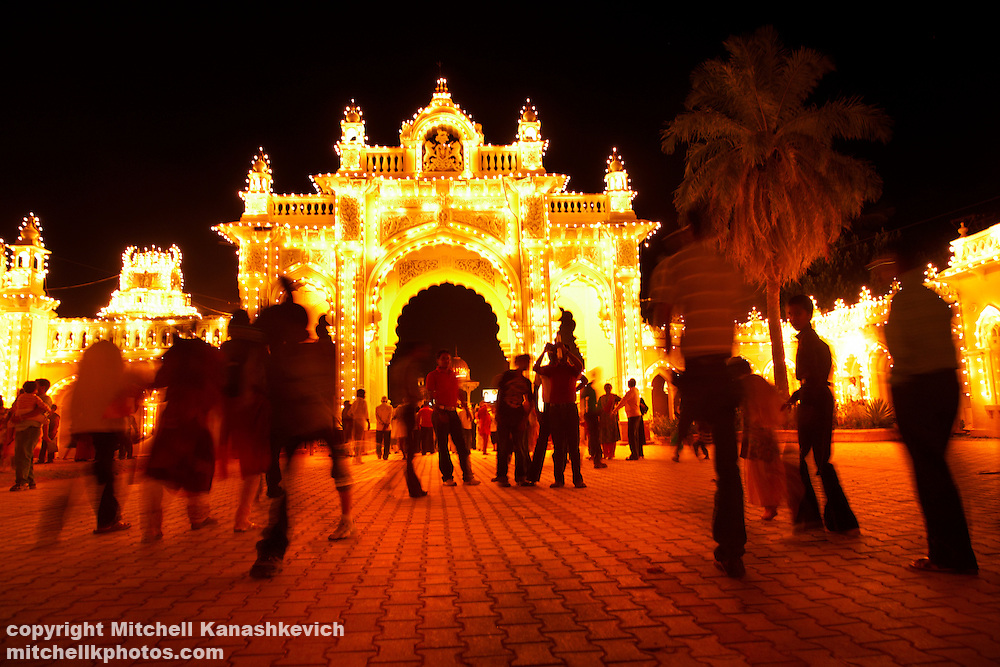 Locals walking around the Mysore Maharaja's Palace on a Sunday evening, when ninety-six thousand light bulbs are switched on for one hour.,Traditions and culture