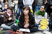 Paris, France. May 27th 2011..En soutien au mouvement de la jeunesse espagnole, 'les Indignes' francais et espagnols font une Assemblee Generale place de la Bastille afin d'amplifier ce mouvement appelle French Revolution sur Twitter..Les fleurs sont un soutien au blesses victimes de violences par la Police le matin meme a Barcelone.