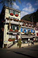 The quaint and decorative facade of Hotel Aarburg in Interlaken, Switzerland