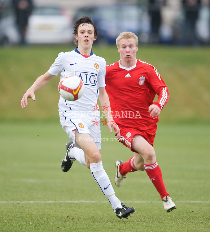 KIRKBY, ENGLAND - Saturday, December 13, 2008: Liverpool's Christopher Buchtmann and Manchester United's Tom Thorpe during the FA Premier Academy Group A match at the Kirkby Academy. (Pic by David Rawcliffe/Propaganda)