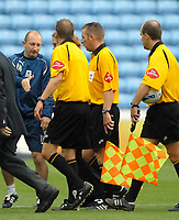 Photo: Ed Godden.<br />Coventry City v Plymouth Argyle. Coca Cola Championship. 30/09/2006. Plymouth Manager Ian Holloway (L) shakes hands with the officials at the end of the game.