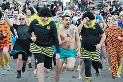 The annual impromptu dip in the sea on Portobello Beach<br /> <br /> <br /> © Jon Davey/ EEm