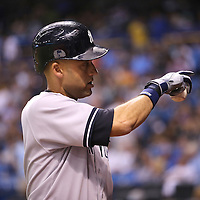 New York Yankees shortstop Derek Jeter (2) is seen in the on deck circle during a major league baseball game between the New York Yankees and the Tampa Bay Rays at Tropicana Field on Thursday, Sept. 17, 2014 in St. Petersburg, Florida. The Yankees won the game 3-2 and this was Jeter's last game against Tampa Bay. (AP Photo/Alex Menendez)