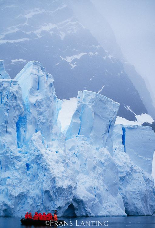 Tourists exploring icebergs by zodiac, Antarctica