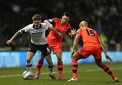 Derby County's Jeff Hendrick takes on Bolton's Alex Baptiste - Photo mandatory by-line: Matt Bunn/JMP - Tel: Mobile: 07966 386802 16/02/2014 - SPORT - FOOTBALL - IPro Stadium - Pride Park - Derby - Derby County v Bolton - Sky Bet Championship