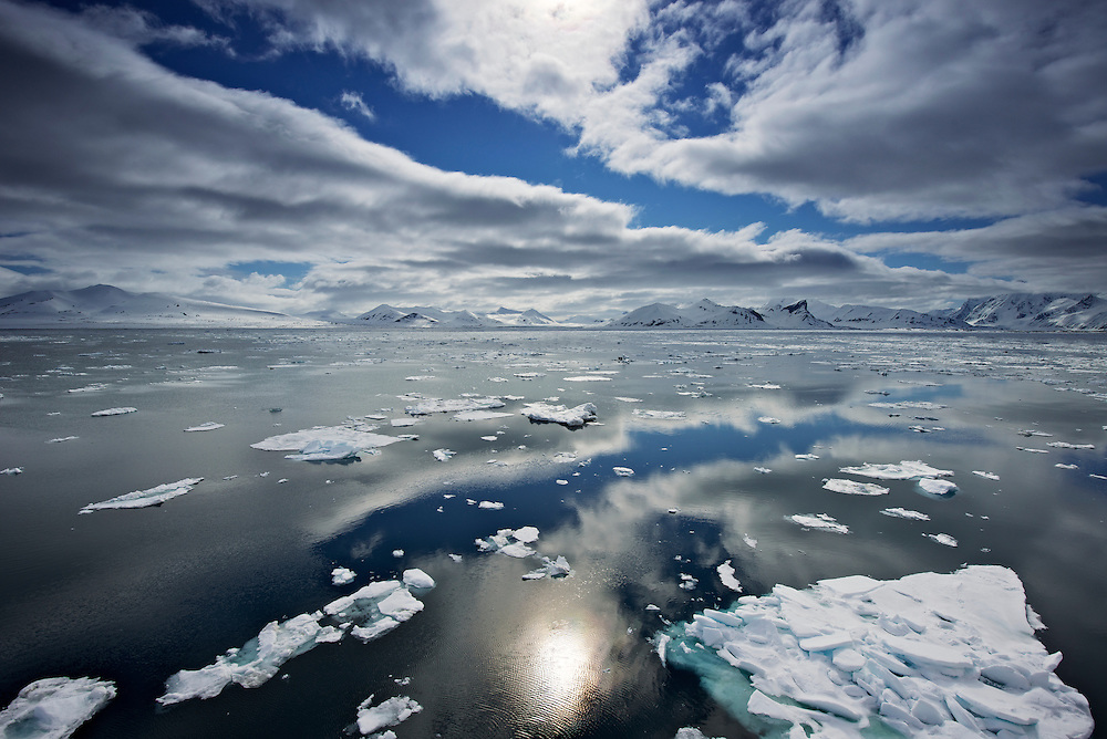 A brilliant day in Svalbard, with calm seas among the ice flows making great reflections.