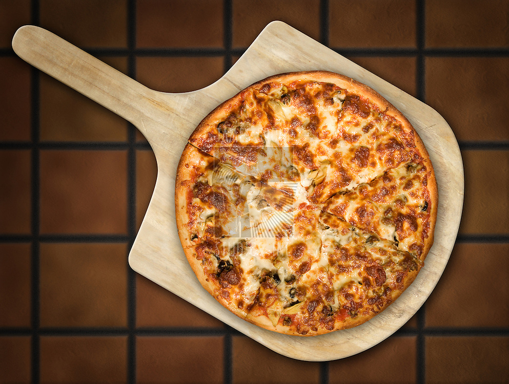 Pizza resting on a wooden pizza peel against a terra cotta tile background