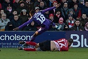 Rushian Hepburn-Murphy (18) & Michael Bostwick (16) during the EFL Sky Bet League 1 match between Lincoln City and Tranmere Rovers at Sincil Bank, Lincoln, United Kingdom on 14 December 2019.