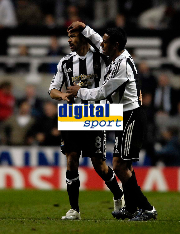 Photo: Jed Wee/Sportsbeat Images.<br /> Newcastle United v AZ Alkmaar. UEFA Cup. 08/03/2007.<br /> <br /> Newcastle's Kieron Dyer (L) is congratulated by team mate Nolberto Solano.