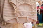 old style woman corset on display at a market