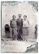 eroding glass plate with man and two women standing in front of a wine storage cuvee