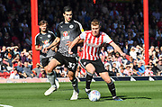 Brentford midfielder Lewis Macleod (4) during the EFL Sky Bet Championship match between Brentford and Reading at Griffin Park, London, England on 29 September 2018.