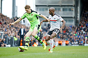Wolverhampton Wanderers midfielder Dave Edwards (4) keeps the ball from Fulham striker Sone Aluko (24)  during the EFL Sky Bet Championship match between Fulham and Wolverhampton Wanderers at Craven Cottage, London, England on 18 March 2017. Photo by Andy Walter.