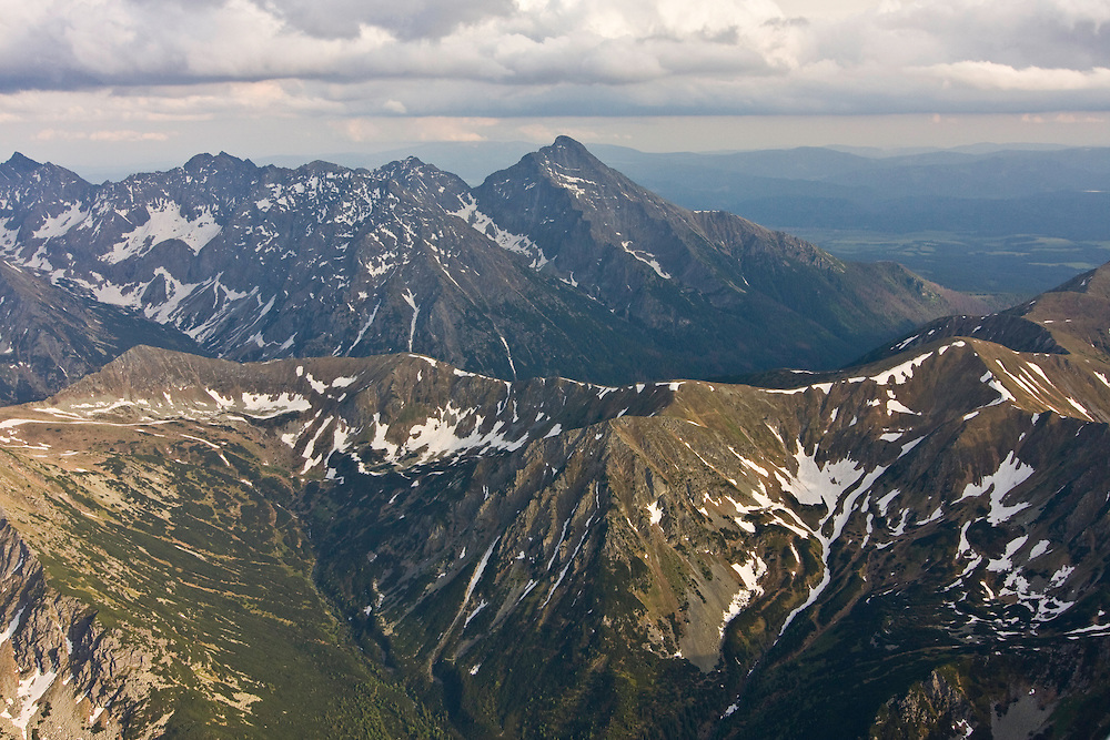 Aerial view of the end of Ticha valley and the High Tatras with Mount Krivan (2495m als) on the right. Western Tatras, Slovakia. June 2009. Mission: Ticha